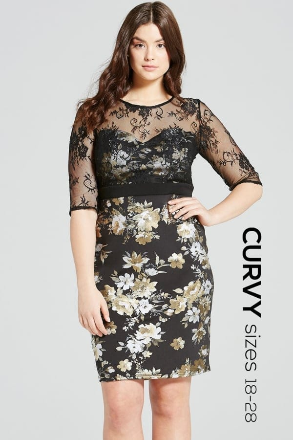 A black dress in a metallic floral print with lace overlay.