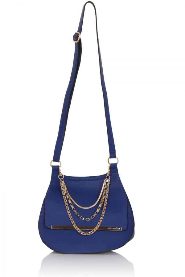 A cobalt round bottom shoulder bag