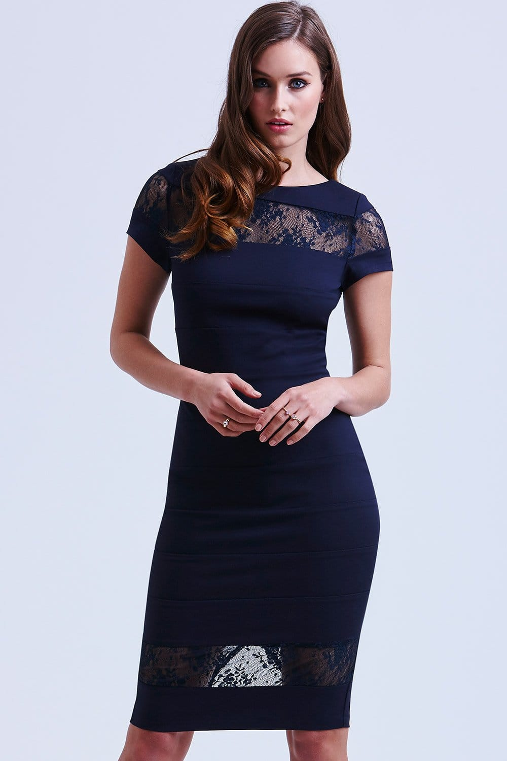 This is a women's lace covered bodycon dress. It comes in your choice of yellow or navy blue. The under layer of this dress is a stretchy, opaque, high quality fabric that is cut close to the body, and that is true to size. A triangular shaped cutout appears in the middle of the bust. This part of the dress has a vee shaped neckline.