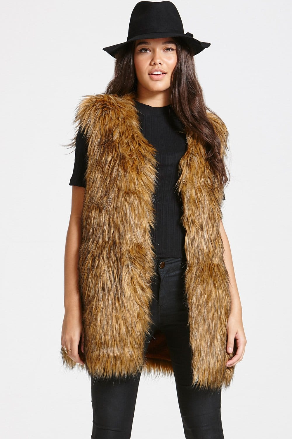 As good as the real deal. This faux-fur gilet is designed in a panelled finish that replicates authentic fur. Clean, simple and versatile, this layering tool can be worn over .