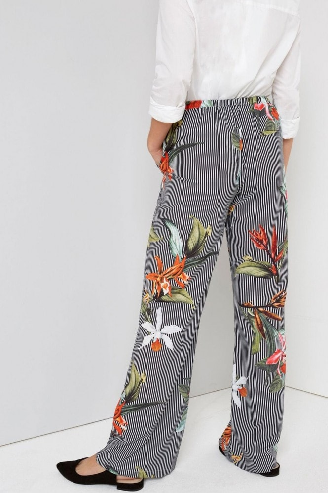 Girls on Film Tropical Print Trousers