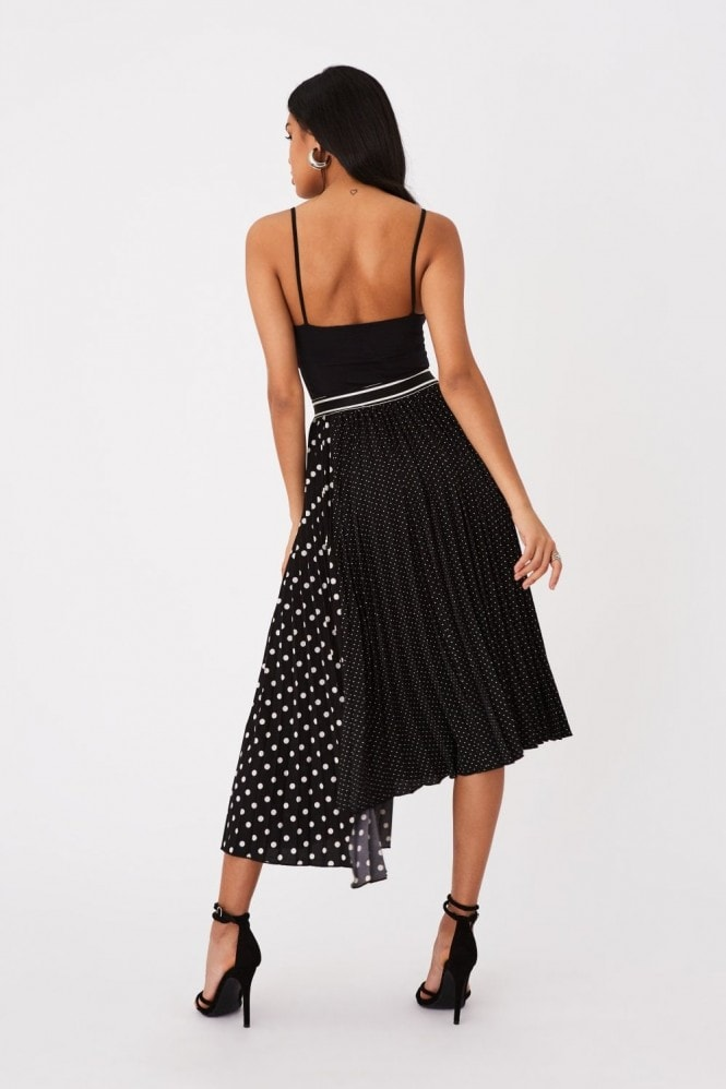 Girls on Film Charity Black Polka-Dot Asymmetric Pleated Midi Skirt