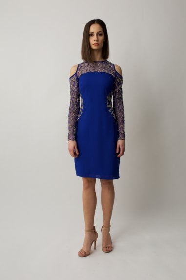 Cobalt blue midi long sleeve dress with cold cut shoulders and gold embelishment on the waist and arms.