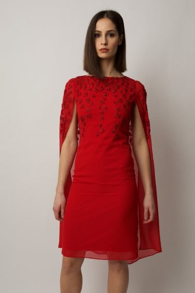Red cape dress with embellishment on the shoulders and chest