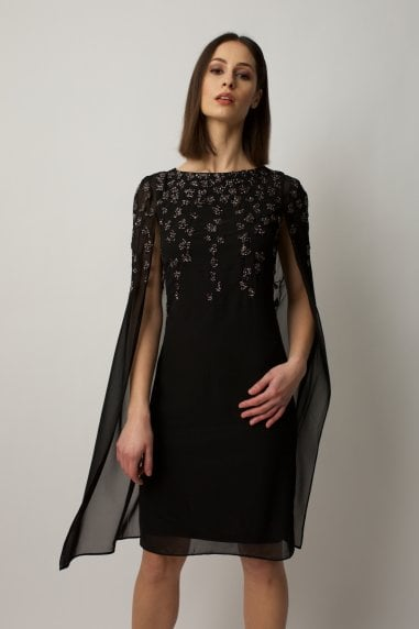Black cape dress with embellishment on the shoulders and chest