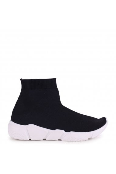 COURTESY - Black Sock Trainer With Chunky White Rubber Sole