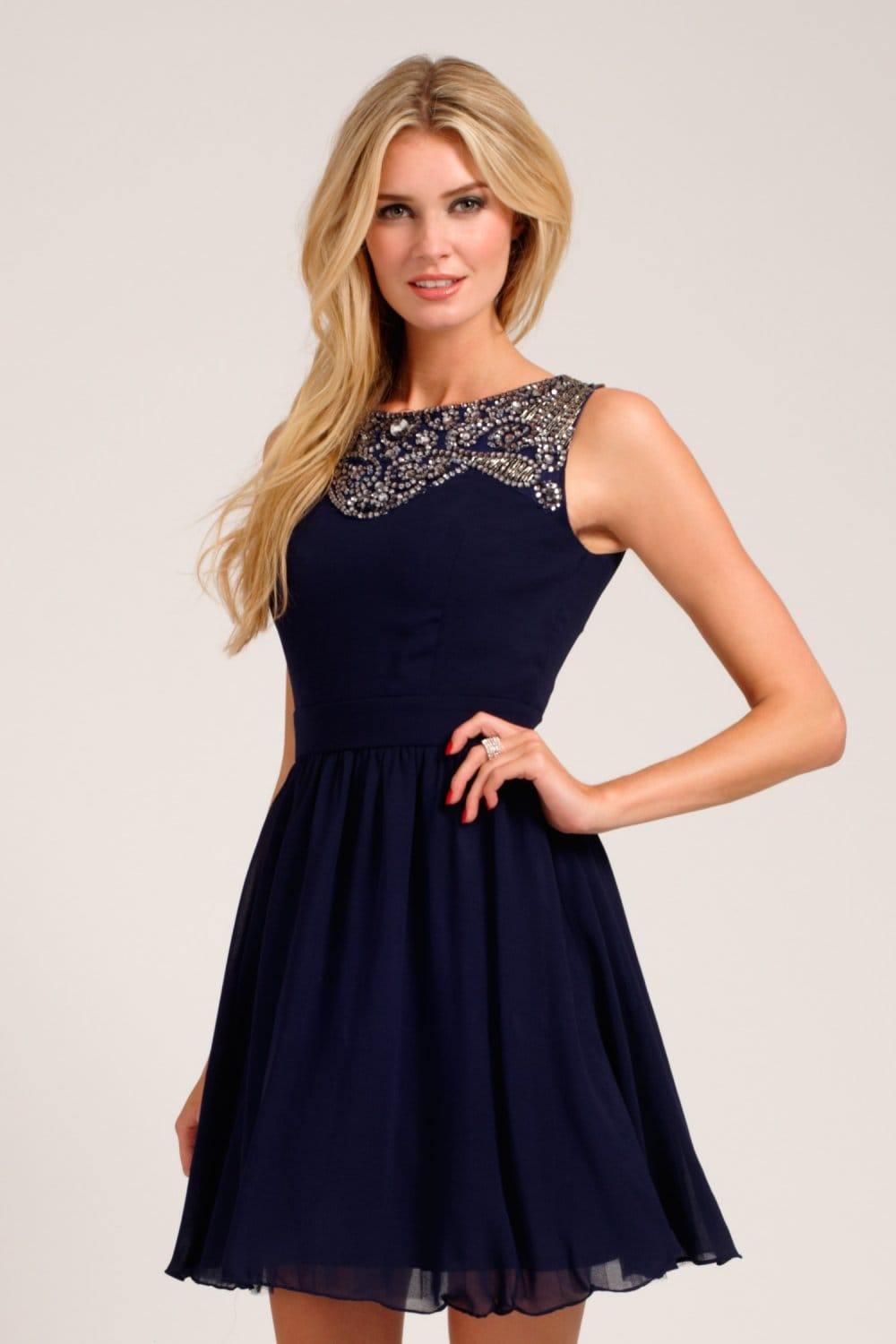 Navy blue is one of the classiest and most timeless colors ever. A navy blue dress, whether short or long, suits every body type. Accessorize it with funky jewelry, attention-grabbing shoes, or other fashion accessories that fit your lifestyle to add an eye-catching sparkle to this elegant hue.