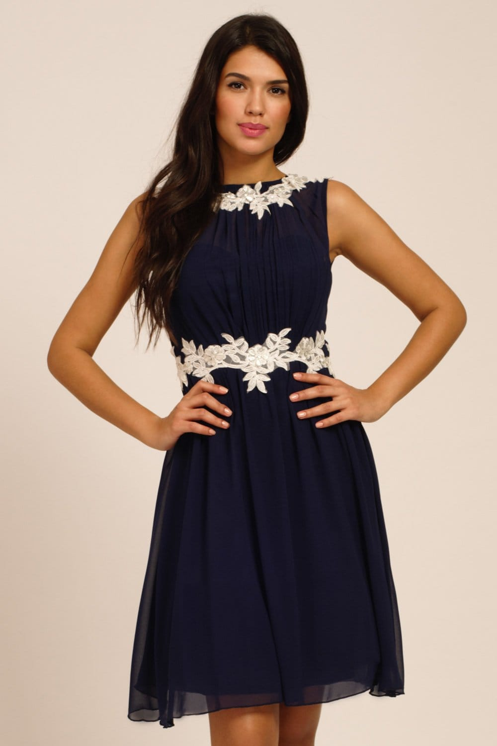 Celebrate your timeless beauty in Lulus The Greatest Navy Blue Lace Maxi Dress! Stunning floral lace overlays a princess seamed bodice with sheer cap sleeves and a backless design (with top button). A cascading, full maxi skirt flows from a fitted waist. Hidden back zipper/hook clasp/5(90).